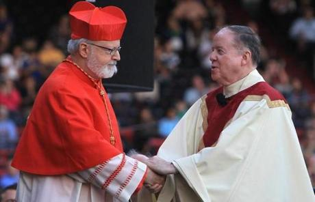 Cardinal Sean P. O'Malley, left,  spoke at the Mass.