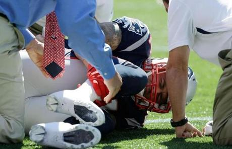 Aaron Hernandez held his lower right leg after a first-quarter injury.