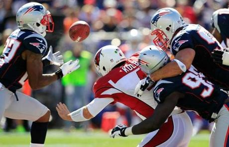 Kolb fumbled into the hands of Patriots safety Tavon Wilson after being tackled by Chandler Jones and Rob Ninkovich.