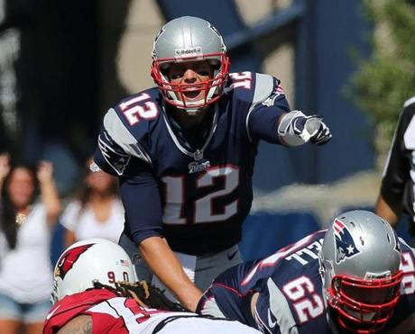 Tom Brady calls a play in the first quarter.