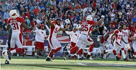 Cardinals players celebrated after Stephen Gostkowski's kick went wide.