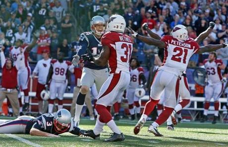 Cardinals players celebrated as Stephen Gostkowski's field goal sailed wide.