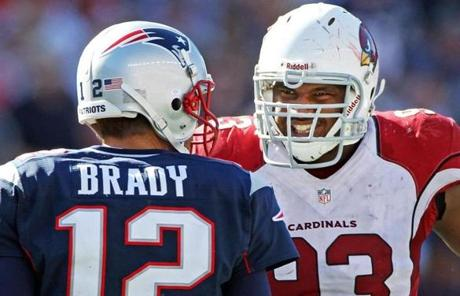 Arizona's Calais Campbell grinned at Tom Brady after the quarterback threw an incompletion late in the game.