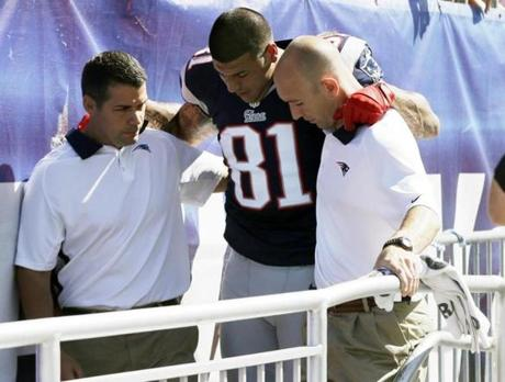 Aaron Hernandez was then helped from the field.