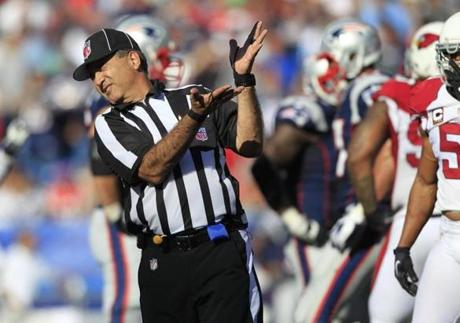 A replacement official reacts to a ball being thrown in the fourth quarter .