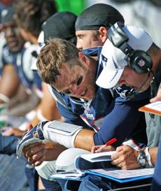 Tom Brady and offensive coordinator Josh McDaniels conferred on the bench late in the game.