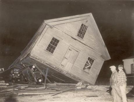 September 23, 1938:  Benson's Garage in Whitman is tossed on its side destroying a truck and two cars in the tumble.