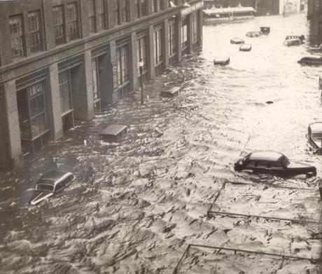 September 22, 1938: Pushed inland by 100 mile an hour hurricane force winds, six feet of water are shown in the heart of Providence, lapping at the tops of automobiles on Sabin Street. The tide was even higher than usual due to the Autumnal Equinox and a full moon.