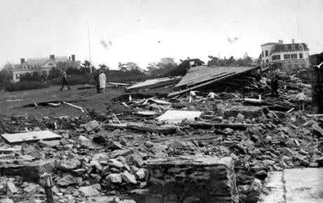 September 26, 1938:  Ocean Ave, the million-dollar section of Newport R.I. shows a house flattened by the storm.