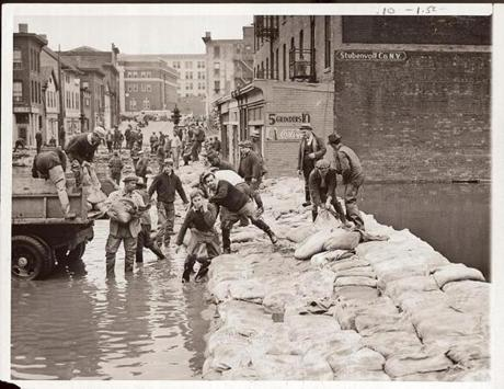 September 23, 1938: More than 1,000 emergency workers hastily erected sandbag levees in Hartford, CT as the swollen Connecticut River continued to rise. Reporting from Hartford to the Globe had to be by short wave radio as all other communication had been cut .Byron Goodman of station W1INF in Hartford and Frank Lewis and Donald E. Kerr of W1MX of MIT collaborated on the report.