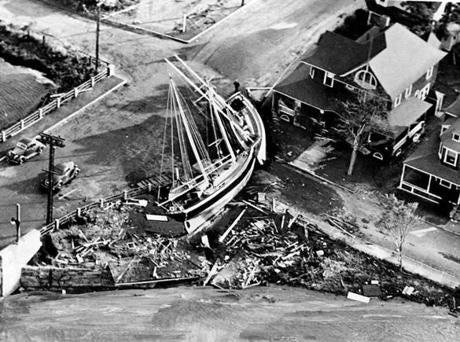 September 26 1938 / fromthearchive / Boston Globe photo / A 12- foot tidal wave pushed up Buzzards Bay by an 80 mile-an-hour wind and laid low all telephone and telegraph communications and breached land in three places. Fifteen person were known dead, scores of people were left homeless and the the property damage was incalculable. Hamilton Garland of Buzzards Bay had his 45-foot yacht