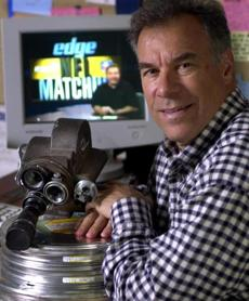 Steve Sabol with an old 16mm movie camera.