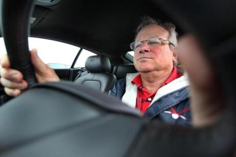 Joe Kahn drove the sports car at a test course across from Gillette Stadium.