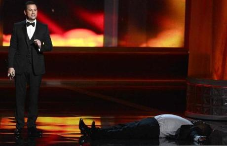 Host Jimmy Kimmel and actor Tracy Morgan onstage at the Nokia Theatre in Los Angeles during the 64th Emmy Awards.