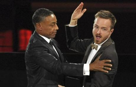 Giancarlo Esposito, left, congratulated Aaron Paul after Paul won the award for outstanding supporting actor in a drama series for
