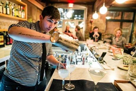 09/21/2012 CAMBRIDGE, MA Bar Manager Fanny Katz (cq) pours a drink at Belly Wine Bar (cq) in Cambridge. (Aram Boghosian for The Boston Globe)