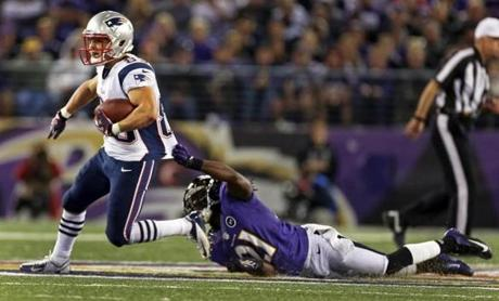 Wes Welker is grabbed by the jersey by the Ravens' Lardarius Webb, but he escaped and picked up some more yardage after a fourth quarter catch.