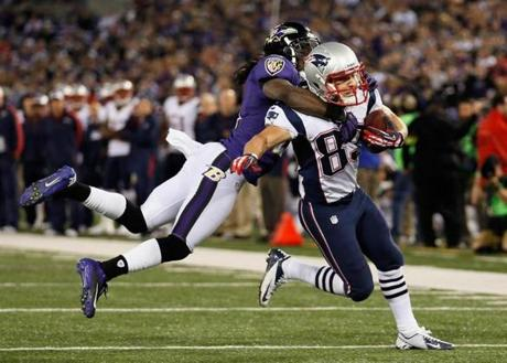 Cornerback Lardarius Webb of the Ravens tackled Wes Welker during the fourth quarter.