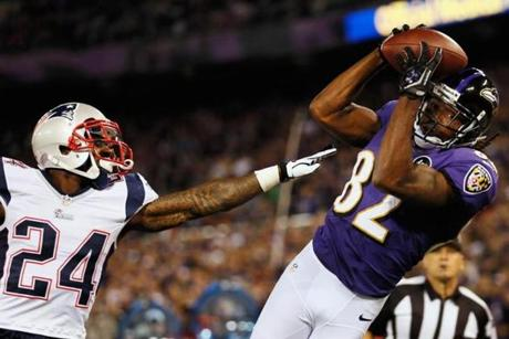 Torrey Smith of the Ravens catches a touchdown pass in the second quarter against Kyle Arrington.