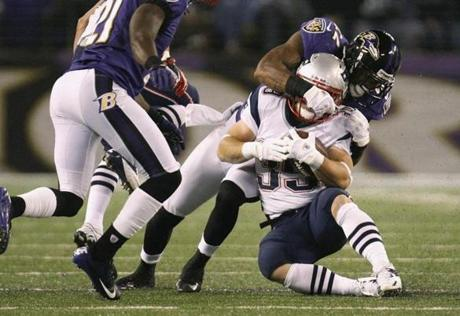 Ravens cornerback Jimmy Smith tackled Patriots running back Danny Woodhead at the end of a run during the first half.
