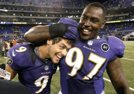 Teammate Arthur Jones celebrated with Justin Tucker.