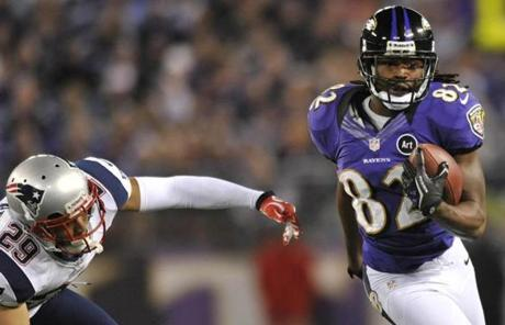 Ravens receiver Torrey Smith rushed the ball past Patriots safety Sterling Moore in the second half.