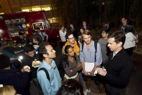 FOR Business. Cambridge, MA 9/24/2012 Jack Dorsey, right in black, speaks with a group of students next to the food trucks that use his product, Square. Dorsey often recruits by speaking to students in informal settings. Jack Dorsey, co-founder of Twitter and the mobile payment start-up Square, comes to MIT on Monday to pitch his mobile payments company in Cambridge, MA on Monday, September 24, 2012. (Yoon S. Byun/Globe Staff) Section: Business Slug: 25square Reporter: farrell LOID: 5.0.2908915579