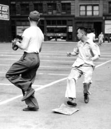July 3 1948 / fromthearchive / Globe file photo / When the automobiles leave the parking lot at Kingston and Beach St. in the twilight hours on weekdays and all day Sunday, the macadam parking lot is transformed into a softball diamond for Boston's Chinatown youth. A long fly ball hit by