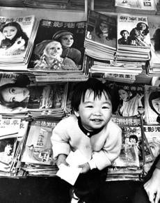 May 16 1974 / fromthearchive / Globe staff photo by Paul Connell / Susanna Lee appears happy to wait on customers seeking to buy popular Chinese magazines.