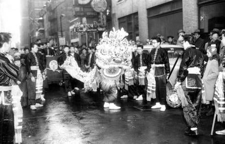 February 3 1957 / fromthearchive / Globe photo by John J. Landers / The din of thousands of firecrackers filled the air on Tyler St. as members of the Gung-Ho Club paraded through the area with the traditional dragon, touching off the Chinese New Year celebration.