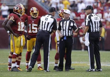 Officials had to confer after several contrary calls in the finals seconds Redskins' loss to the Bengals.