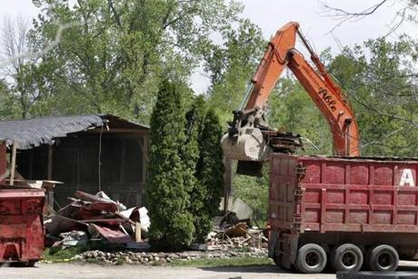 Demolition workers tore down a horse barn for the FBI during a search for Hoffa's body in 2006.