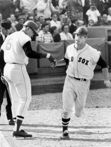 Yastrzemski earned congratulations from George Scott after hitting a home run early in the season.