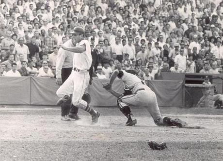 Yastrzemski slid home ahead of the tag for one of his league-leading 112 runs.