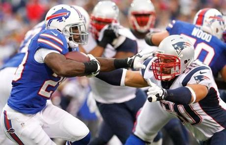 The Bills' C.J. Spiller ran against the Patriots' Rob Ninkovich.