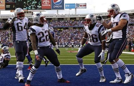 The Patriots celebrated a fourth-quarter touchdown run by Stevan Ridley.