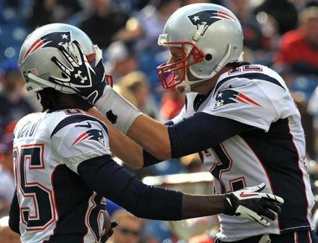 A pumped up Tom Brady celebrated with Brandon Lloyd after the 25-touchdown.