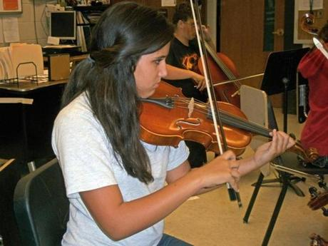 Jacqui Farrow plays her viola at a Bay Youth Symphony strings-only practice at Marshfield High School.