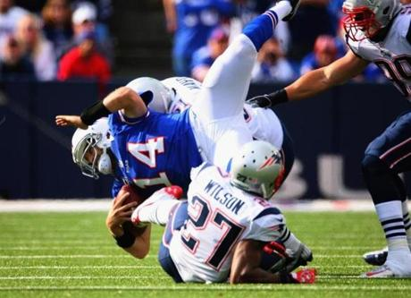 Ryan Fitzpatrick was tackled by Patriots safety Tavon Wilson.