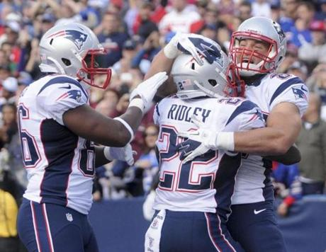 Patriots tight end Daniel Fells, Stevan Ridley and Rob Gronkowski (left to right) celebrated Ridley's touchdown in the fourth quarter.