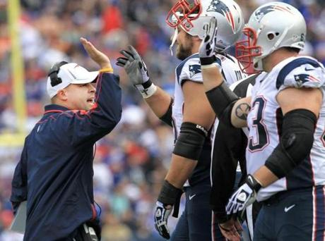 Patriots offensive coordinator Josh McDaniels celebrated with his players on the sidelines.