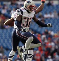 Patriots safety Tavon Wilson celebrated his interception with Devin McCourty  in the fourth quarter.