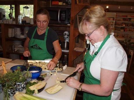 JoAnn Durkin, left, and Marie Bass chop eggplant for a class at The Silo, where, with their friend Jean Bieluczyk, they have taken classes for more than 15 years.