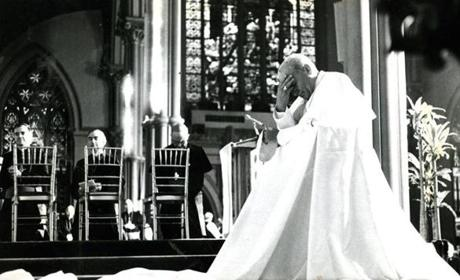 October 1, 1979: Greeted by nearly 2000 priests in a cheering and feet-stomping welcome at the Cathedral of the Holy Cross, Pope John Paul II first made his way to the side altar of St.Joseph, to a waiting prie-dieu covered with a white silken scarf and fell to his knees for a full minute, his head bowed in prayer. He then joined the more than 30 cardinals and bishops assembled on the high altar for Mass.
