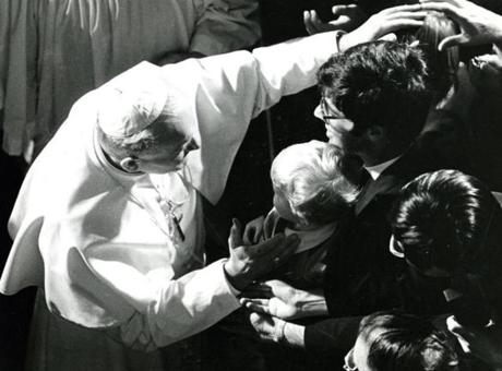 October 1, 1979:  Pope John Paul II blesses the children waiting outside as he enters the Cathedral of the Holy Cross.