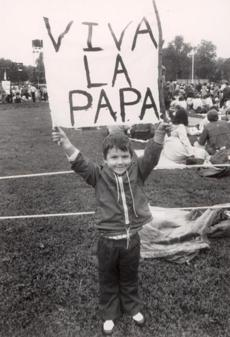 October 1 1979: Anthony Lanzara, 3, of Nashua N.H. holds a papa banner as he waits for a chance to see Pope John Paul II from his spot on Boston Common.