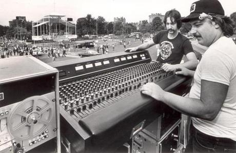 September 28, 1979: Audio engineers Jay Arthur and Robert Dutczak check the lead control board for the papal visit sound system. Capron Lighting and Sound Co. of Needham installed a sound system designed and built by Bolt Beranek & Newman. Two speaker towers 40 feet high will be set up beside the pavilion, three more clusters of speakers will be located 600 feet from the pavilion on 30-foot towers and loudspeakers will be located in trees at seven other places on the Common.
