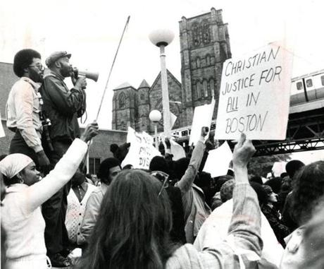 October 1 1979 / fromthearchive / Globe staff photo by Bill Greene / Representative Mel King addresses about 1800 demonstrators protesting in front of the Holy Cross Cathedral over what they said was racism and violence in the city. This was a response to the shooting of black football player Darryl Williams on September 28, 1979 at a football game in Charlestown. A prayer for Darryl Williams was offered at the Mass.