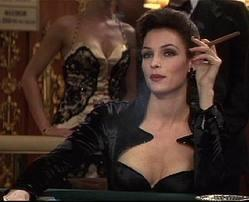 "10. Famke Janssen as Xenia Onatopp in ""GoldenEye"" (1995): A Russian villainess who can crack an enemy like a walnut between her legs deserves an equally frightening wardrobe. Janssen's black widow and searing scarlet ensembles of clinging gowns and leather trousers are suitably sexy and scary enough to keep Pierce Brosnan (and the audience) entangled in her web"
