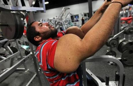Ismail is 5 feet 11 inches tall, 270 pounds, and says he has curled 400 pounds and bench-pressed 500.
